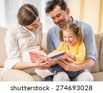 happy parents are reading a... | Shutterstock . vector #274693028