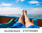 male's feet relaxing on a boat.    Shutterstock . vector #274744484