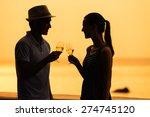 couple enjoying a glass of wine ... | Shutterstock . vector #274745120