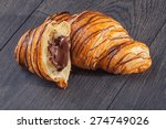fresh croissant on a wooden... | Shutterstock . vector #274749026