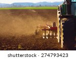 tractor in sunset plowing the... | Shutterstock . vector #274793423