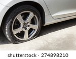 car wheel flat tire on the road | Shutterstock . vector #274898210