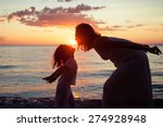 mother and son playing on the... | Shutterstock . vector #274928948