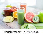 Small photo of healthy eating, food and diet concept- close up of fresh juice glass and fruits on table