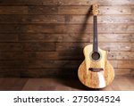 Acoustic Guitar On Wooden...