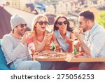 Friends And Pizza. Four Young...