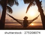 woman relaxing in hammock at... | Shutterstock . vector #275208074