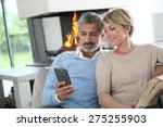 middle aged couple using... | Shutterstock . vector #275255903