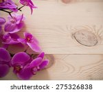 pink orchid flowers on a wooden ... | Shutterstock . vector #275326838