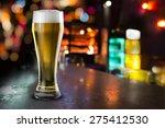 glass of beer with bar scene in ... | Shutterstock . vector #275412530