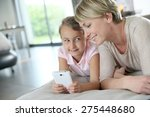 mother and young girl playing... | Shutterstock . vector #275448680