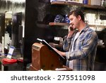 male barber standing by cash... | Shutterstock . vector #275511098