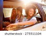 Three Women Sitting In Rear...