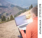 man uses laptop remotely with... | Shutterstock . vector #275531198