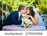 bride and groom posing at the... | Shutterstock . vector #275534558