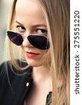 serious girl looking over... | Shutterstock . vector #275551220