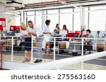staff working in a busy office... | Shutterstock . vector #275563160