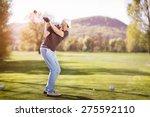 senior golf player teeing off... | Shutterstock . vector #275592110