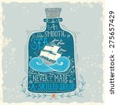 Hand drawn vintage label with a ship in a bottle and hand lettering. This illustration can be used as a print on T-shirts and bags.