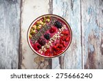 breakfast berry smoothie bowl... | Shutterstock . vector #275666240