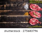 raw juicy meat steak on dark... | Shutterstock . vector #275683796