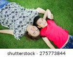 Happy Asian Child With Mother...