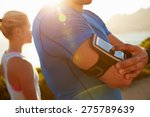 man putting music on before... | Shutterstock . vector #275789639