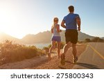 man and woman running together... | Shutterstock . vector #275800343