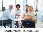 four colleagues meeting around... | Shutterstock . vector #275808353
