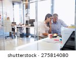 Small photo of Office colleagues working togetherÃ??