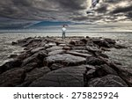 Man With Umbrella On Sea Rock...