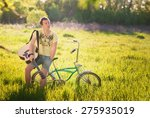 young guy with a guitar sitting ... | Shutterstock . vector #275935019