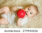 Newborn Baby Boy Playing With ...