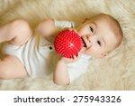 Newborn Baby Boy Playing With ...