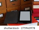 ebook reader in a library   ... | Shutterstock . vector #275963978