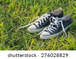 old black sneakers on the grass ... | Shutterstock . vector #276028829