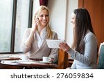 two young women in cafe | Shutterstock . vector #276059834
