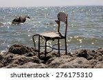 A Broken Chair Sitting Alone O...