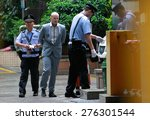 Small photo of GUANGZHOU, CHINA - MAY 7. 2015:Police escort Peter Gardner as he enters court in Guangzhou. An Australian man faced a possible death sentence on charges of attempting to smuggle drugs out of China.