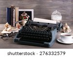 retro typewriter on wooden... | Shutterstock . vector #276332579