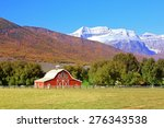 Red Barn With Fall Colors In...