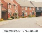 row of modern newly built... | Shutterstock . vector #276350360