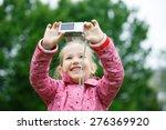little cheerful girl making a... | Shutterstock . vector #276369920