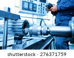 Man operating cnc drilling and...