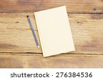 notebook  on wooden table | Shutterstock . vector #276384536