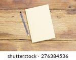 notebook  on wooden table | Shutterstock . vector #276384536