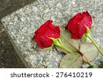 Two Red Roses On The Gravestone