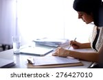 woman with documents sitting on ... | Shutterstock . vector #276427010