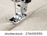 sewing machine makes a seam on... | Shutterstock . vector #276450590