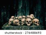Pile of human skulls on stone...